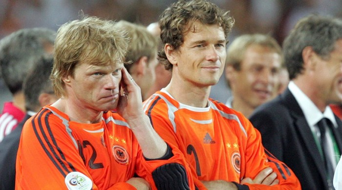 Germany's goal keepers Oliver Kahn, left, and Jens Lehmann wait for the medal ceremony after the World Cup 3rd place soccer match between Germany and Portugal at the Gottlieb-Daimler stadium in Stuttgart, Germany, Saturday, July 8, 2006. Germany won the match 3-1. (AP Photo/Daniel Maurer) ** MOBILE/PDA USAGE OUT **