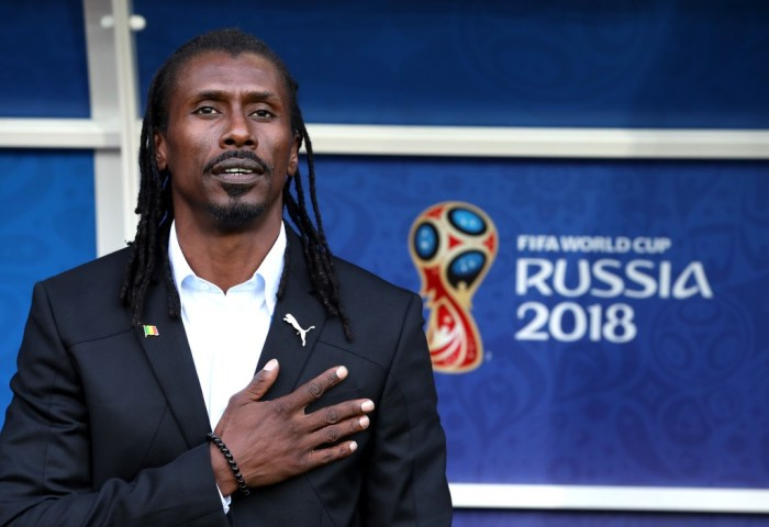 MOSCOW, RUSSIA - JUNE 19: Aliou Cisse, Head coach of Senegal sings national anthem prior to the 2018 FIFA World Cup Russia group H match between Poland and Senegal at Spartak Stadium on June 19, 2018 in Moscow, Russia. (Photo by Catherine Ivill/Getty Images)