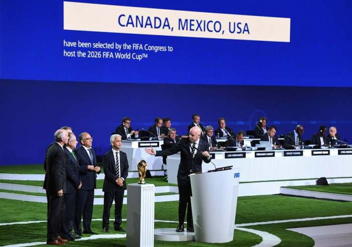 FIFA president Gianni Infantino (R) addresses the United 2026 bid (Canada-Mexico-US) officials Carlos Cordeiro, president of the United States Football Association, president of the Mexican Football Association Decio de Maria Serrano, Steve Reed, president of the Canadian Soccer Association, following the announcement of the 2026 World Cup host during the 68th FIFA Congress at the Expocentre in Moscow on June 13, 2018. / AFP PHOTO / Kirill KUDRYAVTSEV