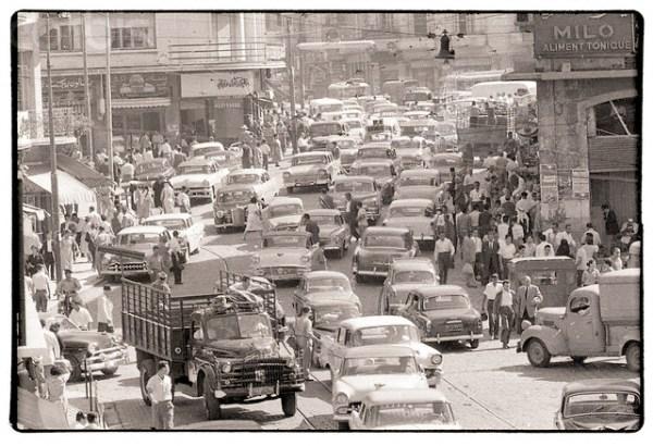 Pedestrians and Cars Crowd Beirut Street