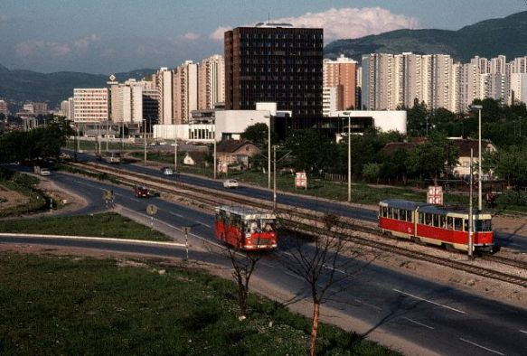 Bus and Train Near Apartment buildings