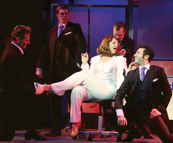"Violet Newstead (Annie Edgerton), center, enjoys the idea of being a female CEO and ""One of The Boys"" in 9 to 5, The Musical."