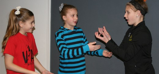 Pictured are Hailey Reed (age 10 from Fishers), Abbie Burns (age 10 from Carmel), and Bella Doss (age 11 from Westfield) during a Rising Stars workshop. Fun theatre games were used to teach students improvisational skills. (Submitted photo)