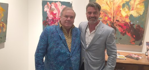 The featured artists and lifelong friends Hunt Slonem (left) and Carmelo Blandino (right), with two of Blandino's paintings.