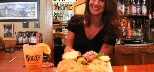 Brittany McCoy holds a tenderloin sandwich from Woodys Library Restaurant. (Photo by Sam Robinson)