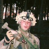 """Zionsville native Dustin Long holds a gernade during active duty with the Marine Corp. """"We should absolutely not go back into Iraq,"""" Long said. (Submitted photo.)"""