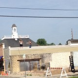 A crew from Nazareth Building Services tears down what used to be Nana's Market. (Photo by Sophie Pappas)