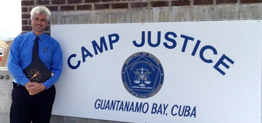 Jeff Papa stands at the entrance of Guantanamo Bay. (Submitted photo)