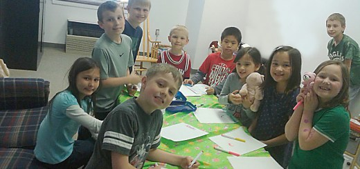 Students at the R.O.C.K. program at Zionsville United Methodist Church work on an edition of their newspaper, ROCK, Paper, Scissors. (Photo by Heather Lusk)