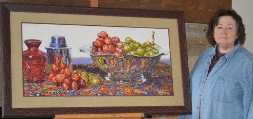 "Joyce K. Jensen, with her painting ""Grapes in Silver,"" watercolor, 18 x 38"". (Submitted photo by Marlena Jensen.)"