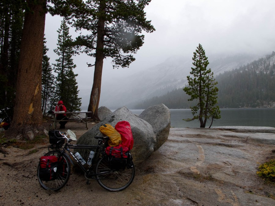 in the high Sierra cold and wet weather can happen anytime (picknick at Tenaya Lake)