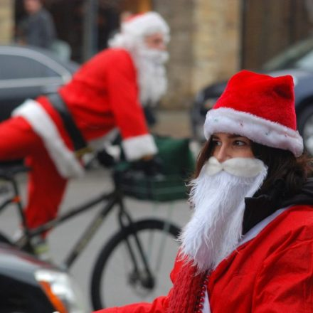Cycling Santa's by Jim Wend