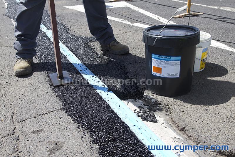 Reparación de junta de dilatación en pavimento asfáltico - 14