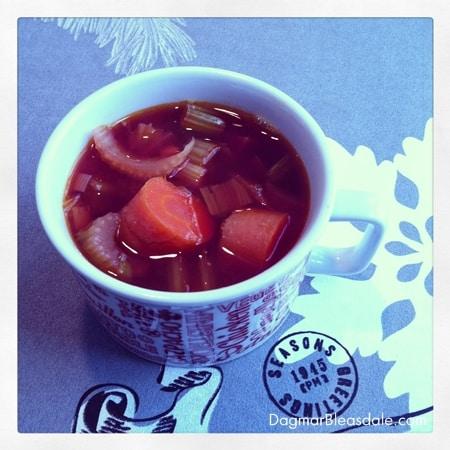 vegetable soup in vintage soup mug, on placemat