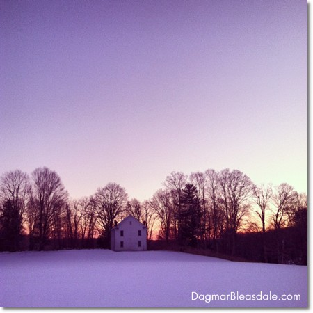 old little church in the snow, at sunset
