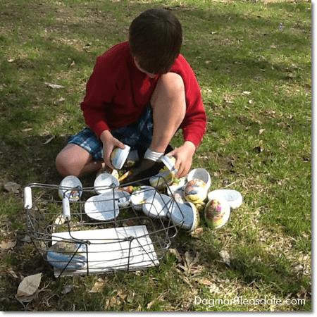 boy opening Easter eggs after Easter egg hunt