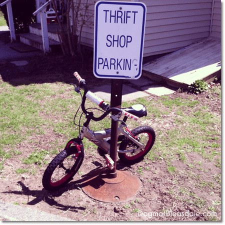 thrift store parking sign and kid's bike