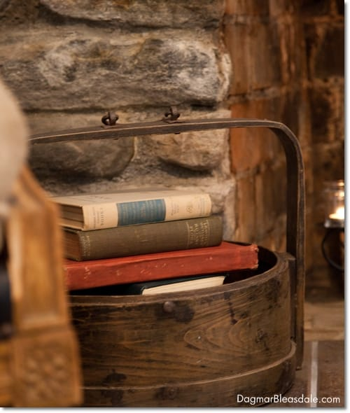 wooden bucket with books in front of fireplace