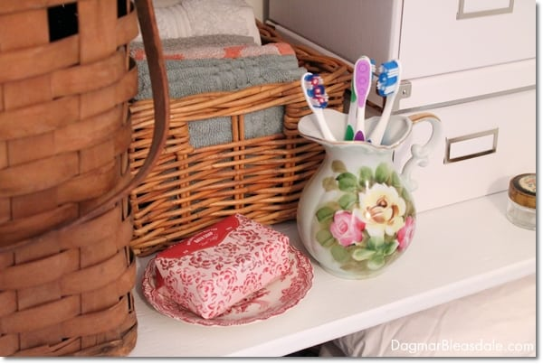 vintage flower vase used for storage of toothbrushes