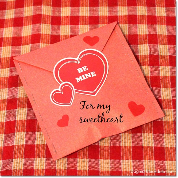 Valentine's Day envelope with staples and chocolate