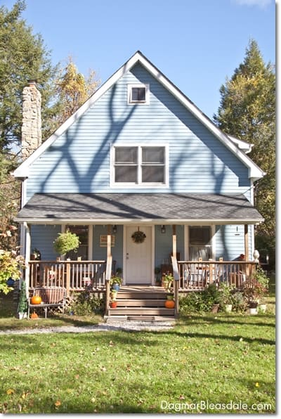 blue cottage porch in the fall