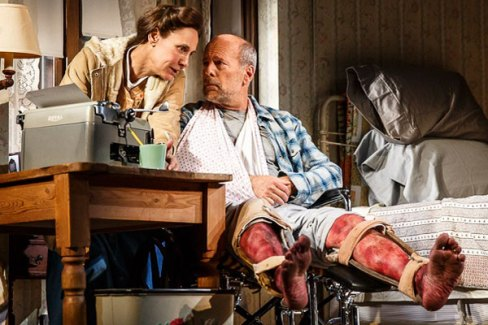 """Laurie Metcalf portrays Annie Wilkes, and Bruce Willis portrays Paul Sheldon during a performance of """"Misery"""" at the Broadhurst Theatre in New York. Photo by Joan Marcus."""