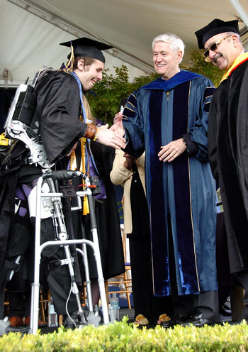 Austin Whitney, who has been paraplegic for four years, walked across the stage to receive his diploma.