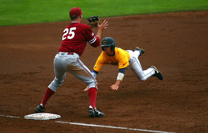 Cal second baseman Tony Renda dives for third base after running from first on a single. He was thrown out to end the third inning.