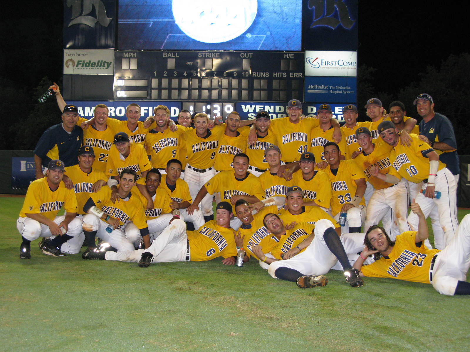 The Cal baseball team celebrates and poses for the camera after scoring four runs in the bottom of the ninth inning to defeat Baylor.