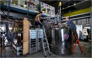 Two students work on the apparatus at CERN, the European Organization for Nuclear Research, where physicists trapped antimatter atoms for as long as 1,000 seconds.