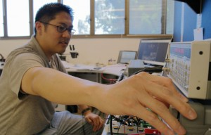 Chris Tiu, a power supply engineer, works on a project at UC Berkeley's Space Sciences Laboratory, which collaborated with NASA to move a probe into orbit around the moon.