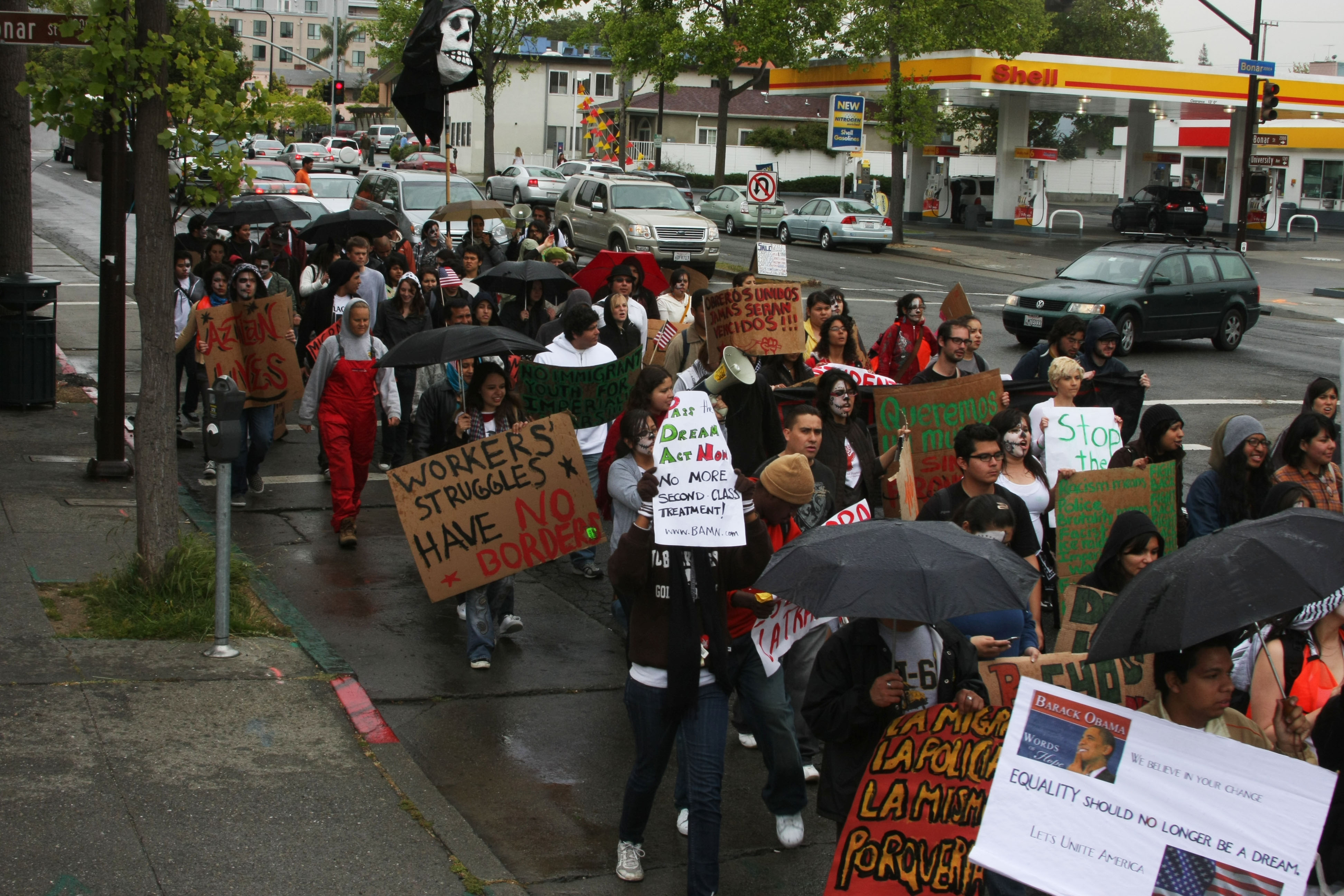Demonstrators protest during a march for immigrant rights down streets in the Berkeley area on May 1, 2009.