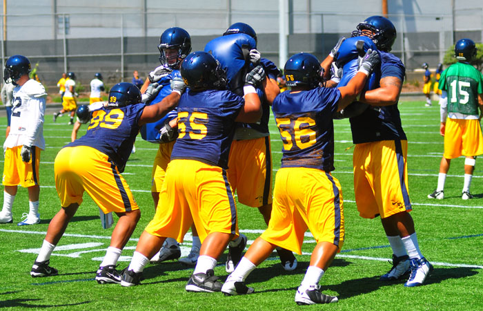 Defensive linemen Gabe King (99), Viliami Moala (55) and Keni Kaufusi (56) participate in drills at Fall Camp. The season starts on Sep. 3 against Fresno State.