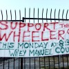 "A sign in support of the ""Wheeler 9"" hanging on the fence around the vacant lot on the corner of Telegraph Avenue and Haste Street."