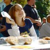 A member of the Berkeley College Republicans sits behind the Increase Diversity bake sale table on Upper Sproul Plaza.