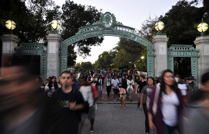 Students and community members pass through Sather Gate on their way to a meeting in the Multicultural Community Center.