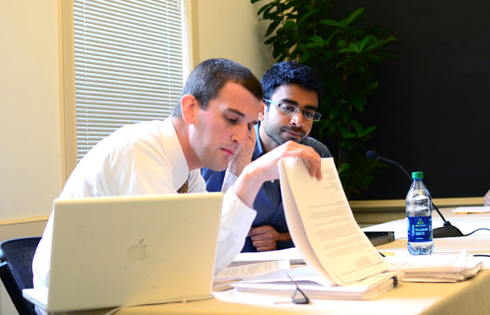 Aakash Desai (right), a graduate student who was involved in the November 2009 Wheeler Hall occupation, sits beside his adviser, Thomas Frampton (left), at a student conduct hearing in April. Desai filed a grievance alleging unfair application of campus policies.