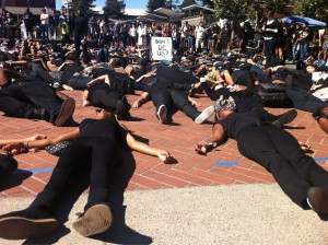 Hundreds of protesters maintain their silence as they lie in Sproul. - Curan Mehra/Staff