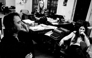 Toni Martin (center), the first Editor-in-Chief of the independent Daily Californian,  sits with Jim Branson (left) and Trish Hall (right) in a staff meeting.