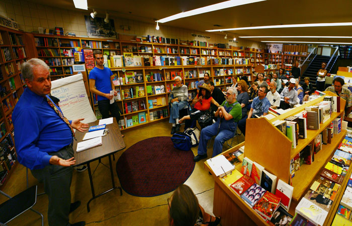Berkeley Council Member Kriss Worthington spoke with business owners and community members concerned with the state of Telegraph Avenue at Moe's Books in October.