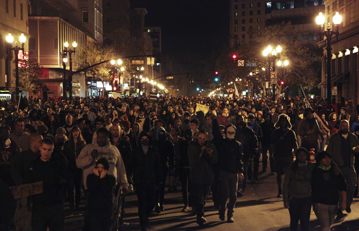 A mass of protesters marched the streets of downtown Oakland on Wednesday night.