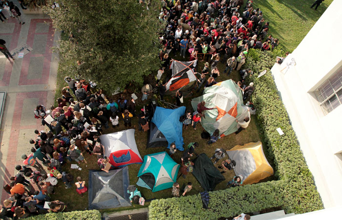 Protesters clashed with police in front of Sproul Hall over an encampment set up by the demonstrators.