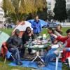 Members of Occupy Berkeley sit at a table in Martin Luther King Park in Downtown Berkeley.
