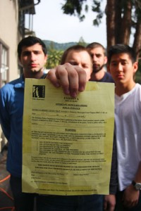 Curtis Hendrickson, former President of the TKE fraternity holds up a second response notice issued to their house.