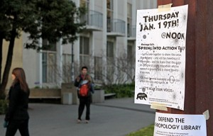 Signs around campus promote the first Occupy Cal event after winter break.