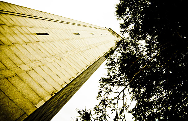 A cross-processed and heavily vignetted photo of UC Berkeley's iconic structure, the Campanile.