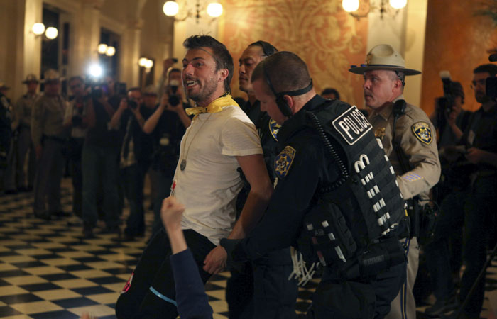A number of protesters were arrested in the Capitol building following their decision to stay and occupy the space.