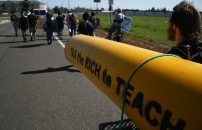 A giant pencil is carried by marchers on their way to Sacramento for the March 5 Day of Action. Jan Flatley-Feldman/Staff