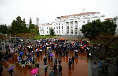 Protesters gathered on Sproul for a noon rally, despite occasionally heavy rain. Jan Flatley-Feldman/Staff
