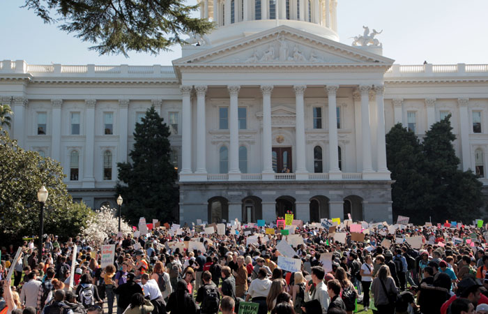 Thousands of protesters gathered in front of the Capitol building in Sacramento for the March 5 Day of Action. Jeffrey Joh/Staff